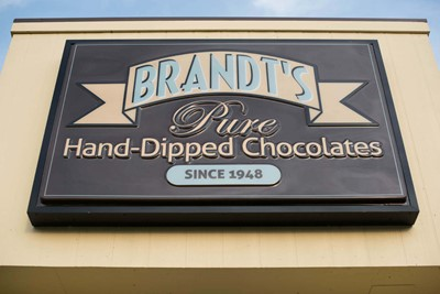 Brandt's using Illuminated cabinet sign and wooded post and panel