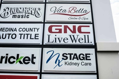 GNC channel lettering, window and graphic wall signs