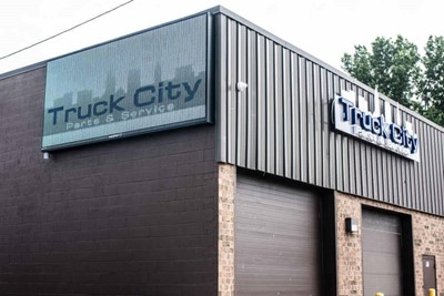 Truck City channel lettering, window and wall graphic signs